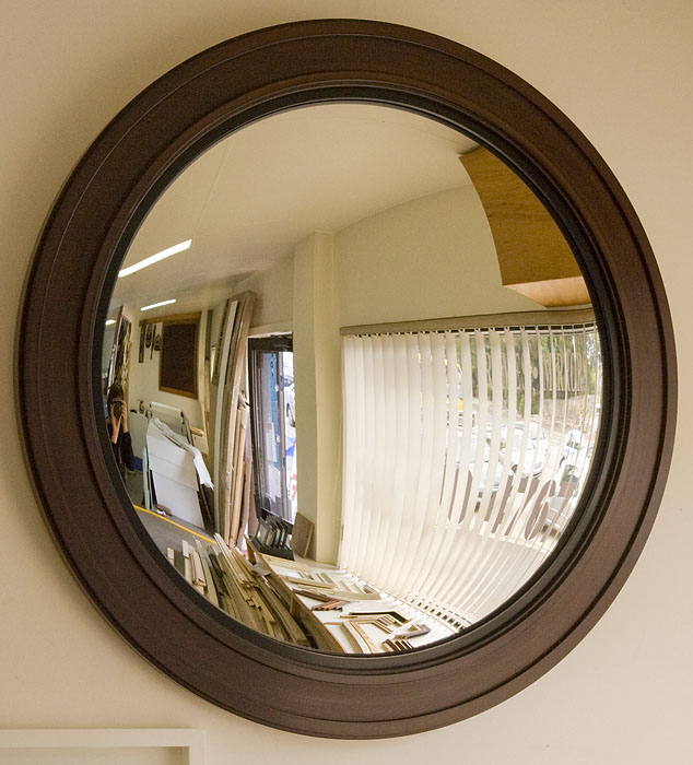 Machined mirror with faux cedar finish