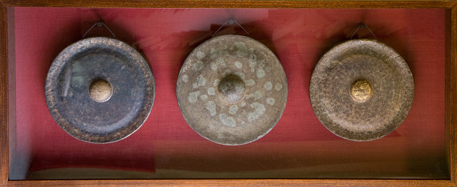 Large Vietnamese gongs in display case