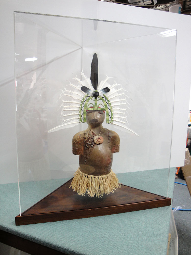 Thursday Island ceramic figure in display case